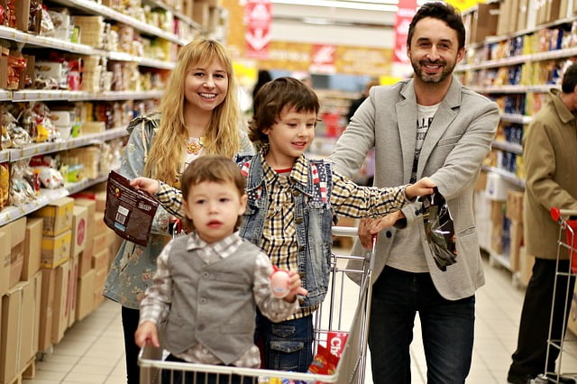 family shopping with kids in grocery store