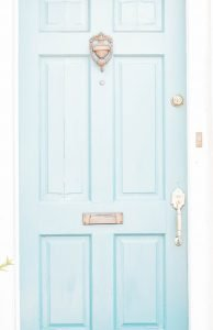 Simple blue door showing simple frugal living